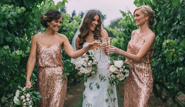 Bride and bridesmaids are toasting at the garden- Lancemore Hill Country Estate