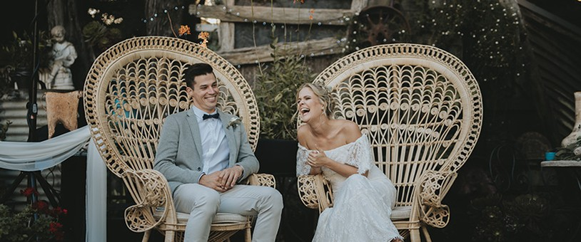 A wedding couple laughing at Oakdene Vineyards and Cellar Door