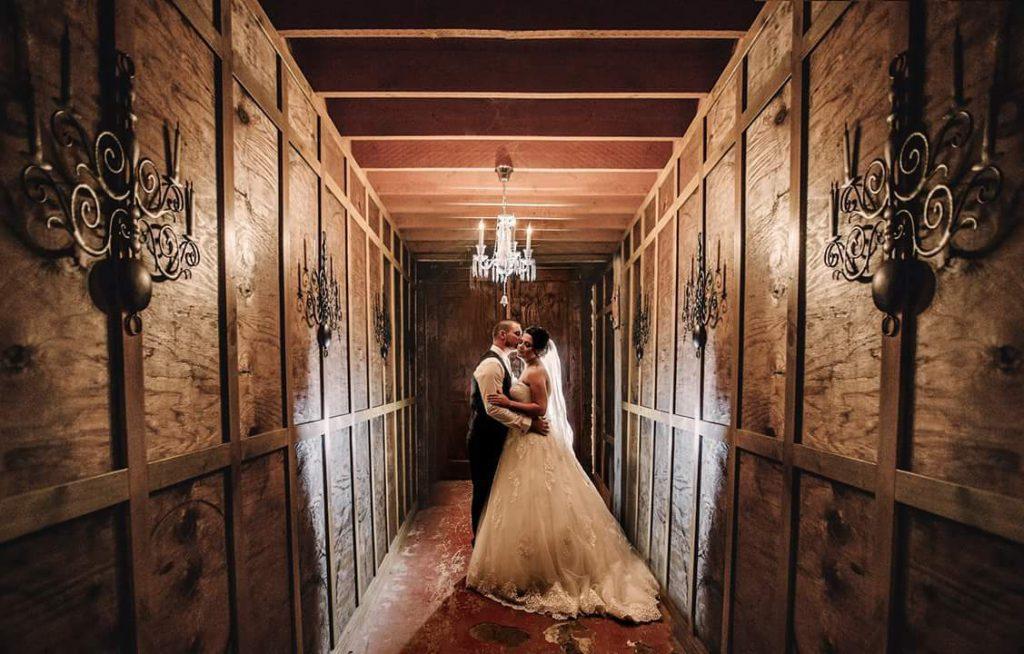 A wedding couple dance at a rustic corridor of Roombas at Mt.Aiken