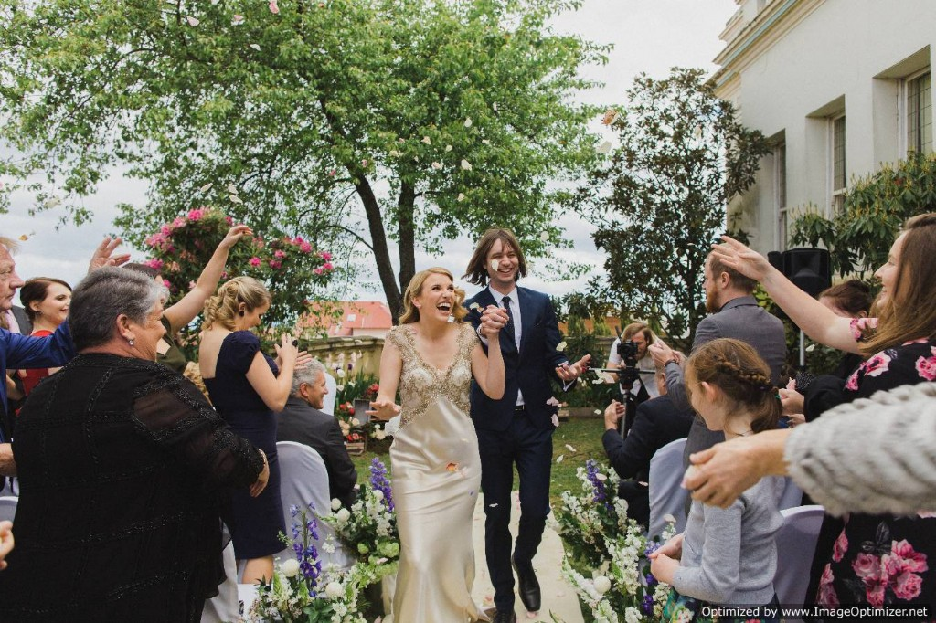 A couple walking amid flower shower