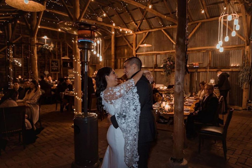 A wedding couple dancing in the shed of Collits Inn