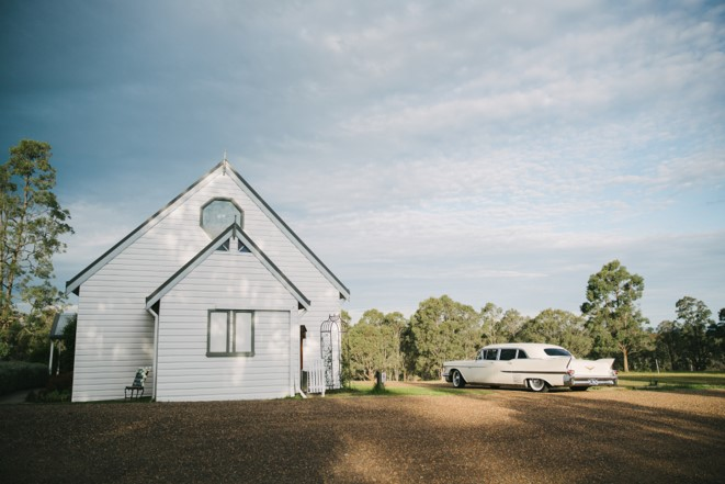 Lovedale wedding chapel with white vintage car