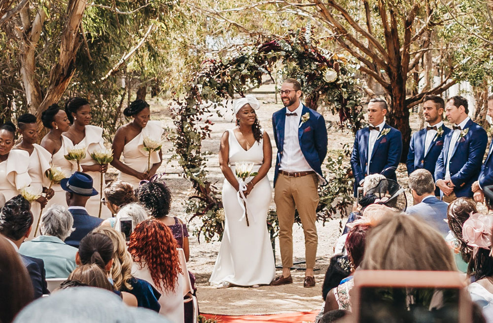 A couple get married under the natural shade of the Oneday winery