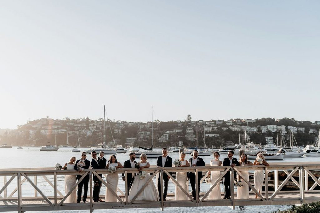 Couples, Groomsmen, Bridesmaids are standing on the jetty of Sydney Port