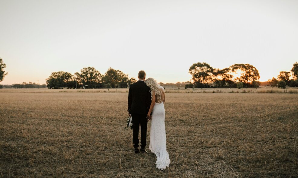 A couple standing on the courtyard of Brown Brothers Winery