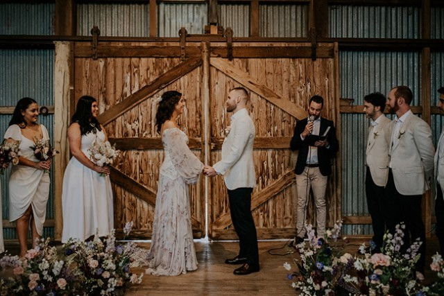Exchanging a wedding vow in a tin barn