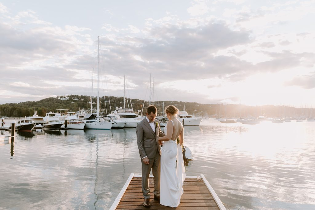 A couple is standing at a jetty