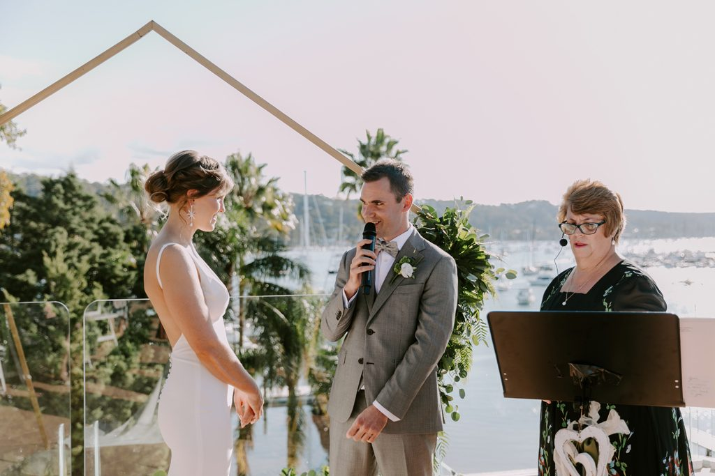 A couple is exchanging vows with Sydney port as a backdrop