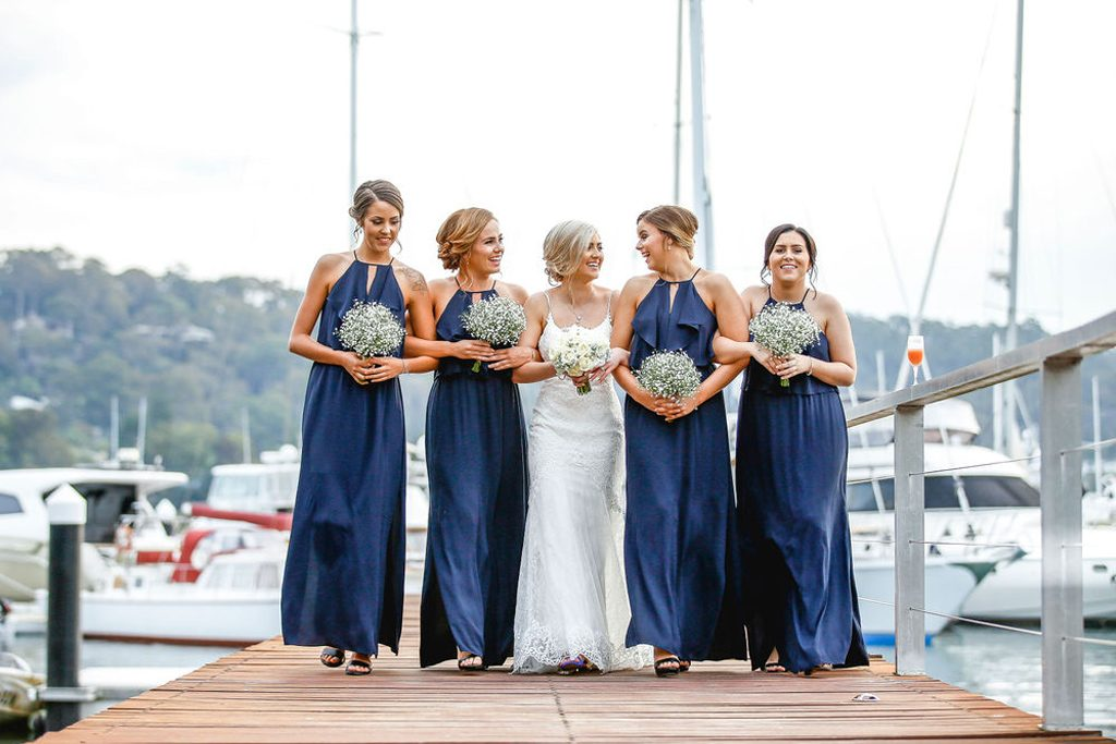 Bride and bridesmaids on the jetty