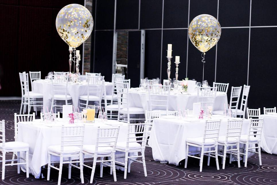 Round tables with balloon in the middle